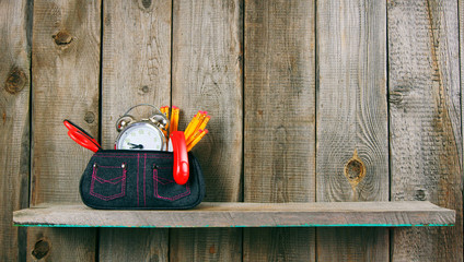 School tools in a case. On wooden background.