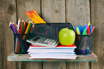 Writing-books, apple and other school accessories.
