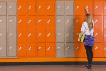 Student unlocking school locker