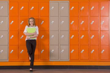 Student leaning on school lockers