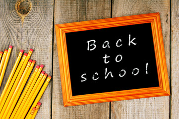Back to school. Frame and pencils.