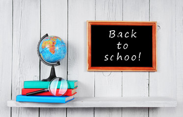 Back to school. The globe and books .