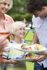 Happy multi-generation family enjoying barbecue