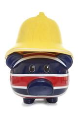 piggy bank wearing firemans helmet