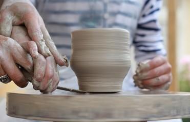 Children's hands creating new vase