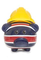 piggy bank wearing builders hard hat