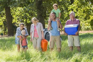Multi-Generation Family Enjoying Camping In Countryside