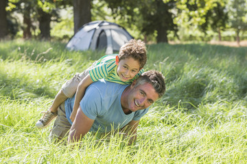 Father And Son Having Fun On Camping Trip In Countryside