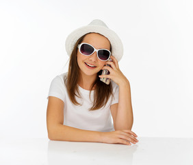 Trendy young girl chatting on her mobile