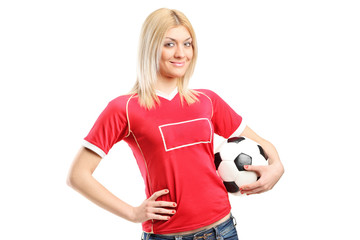 Female football fan holding a ball