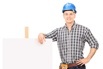 Male repairman leaning on a blank banner