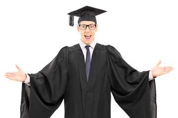 Male student in graduation gown gesturing with hands