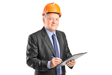 Mature construction supervisor holding a clipboard