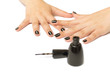 Female hands with black manicure and nail polish bottle