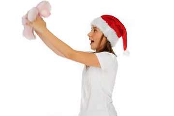 Excited young girl in a Santa Hat