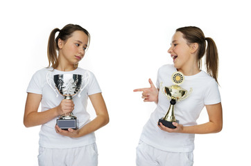 Two Young Pretty Girls Holding Trophies Pose