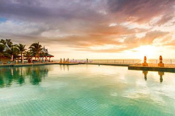 Tropical sunset at the swimming pool in Thailand