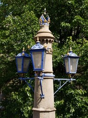 ornamental pillar of street lamp in Krakow