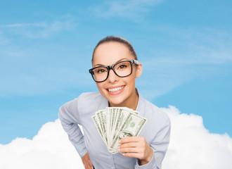 smiling businesswoman with dollar cash money