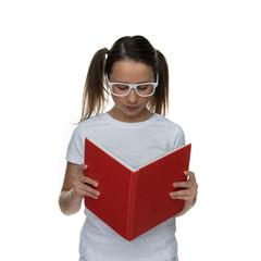Young schoolgirl in glasses standing reading