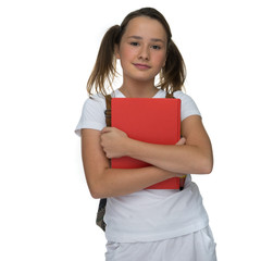 Young schoolgirl clutching a text book