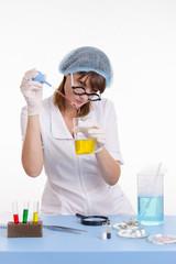 Chemistry teacher conducting experience