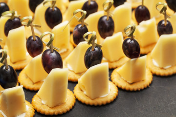 canapes with cheese, grapes