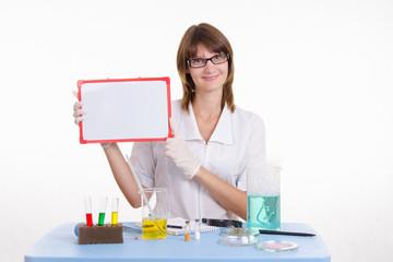 Chemist holding a tablet