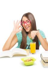 Cute teenage girl feeling okay while learning for school