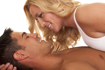 woman lay on man look at each other smile