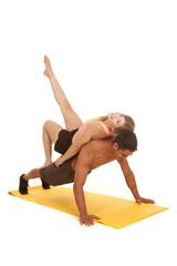 woman laying on man doing pushup leg up