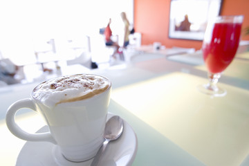Cappuccino on bench in cafe