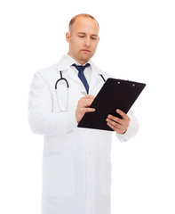 serious male doctor with clipboard and stethoscope