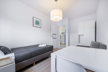 Compact, white sleeping room interior design
