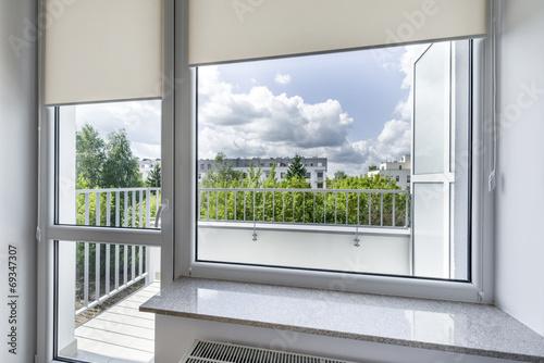 Leinwanddruck Bild Window in small, economic room