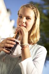 A teenage girl drinking.