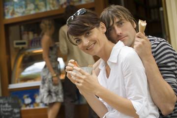 A couple having ice cream.