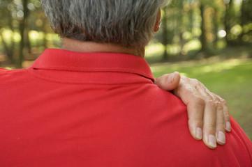 An elderly man with a backache.