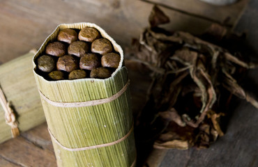 Typical Cubano cigars and leaves