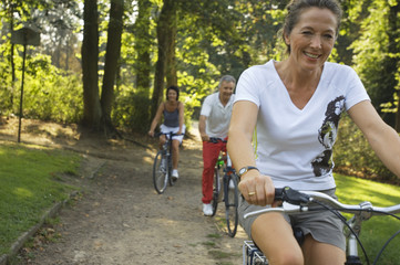 Mature adults cycling.