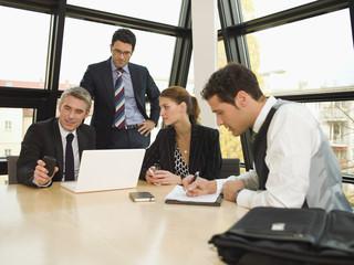 Business people brainstorming.