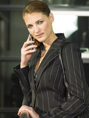 A business woman talking on her mobile phone.