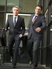 Two businessmen leaving office.