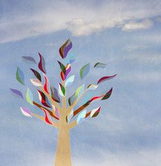 tree with colorful leaves on a background of sky with clouds,