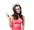 Young girl with headphones on white background