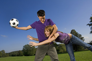 Friends playing football.