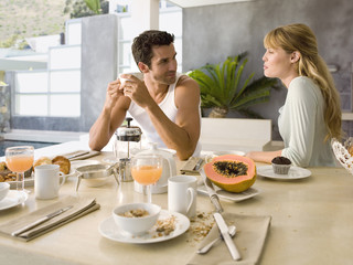 A couple at the dining table for breakfast.