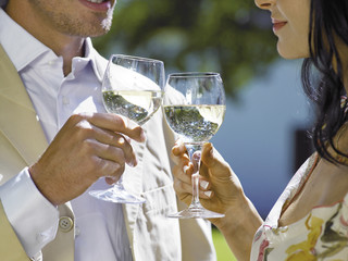 Couple drinking white wine.
