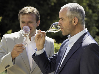 Men drinking wine.