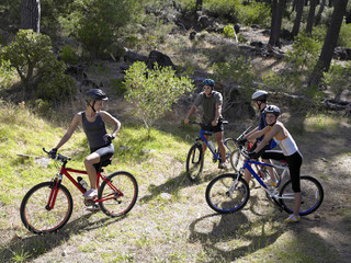 High angle view of two young couples mountain biking
